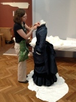 I am putting the finishing touches on the collar before the blue dress is moved into her case.